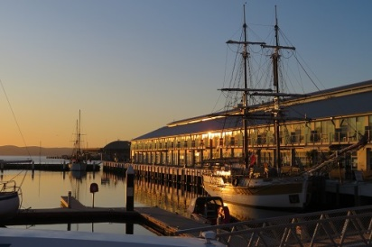 Sunrise over Constitution Dock Hobart with an old sailing boat moored at Constitution Dock