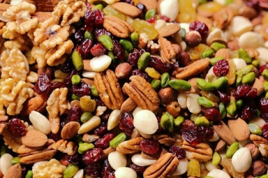 A close up photo of trail mix nuts and cranberries. Photo by Maksim Shutov on Unsplash