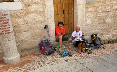 So glad to sit down and get those shoes off on the camino via de la plata in Spain