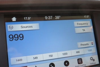 Car dashboard showing a very hot temperature at 0937