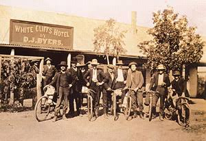 A group of old men outside the White Cliffs Hotel. whitecliffscopal.com