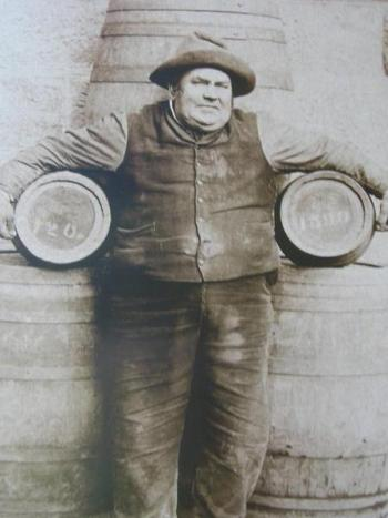 Fatty Appleton holds two large beer kegs under each arm - cascade brewery
