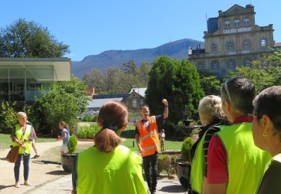 Tour guide at Cascade Brewery with Mt Wellington behind, Hobart