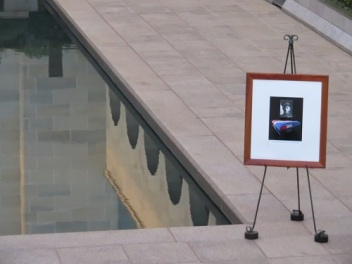 A photo of Private Brown stands at the end of the Pool of Reflection at the Australian War Memorial